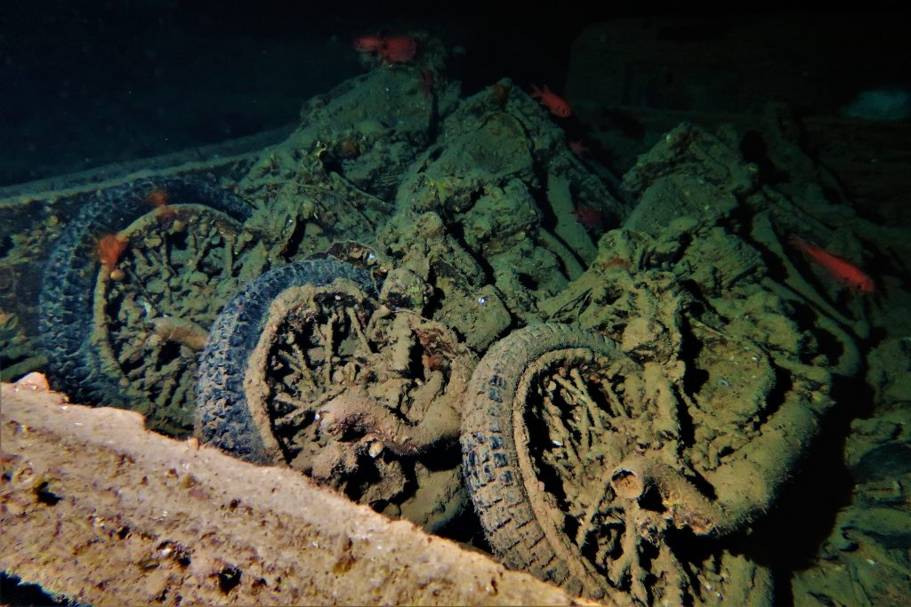Truck loaded with motorcycles in the cargo hold of the Thistlegorm wreck.